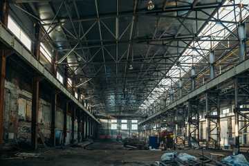 Ruined industrial hall of warehouse or hangar in process of reconstruction