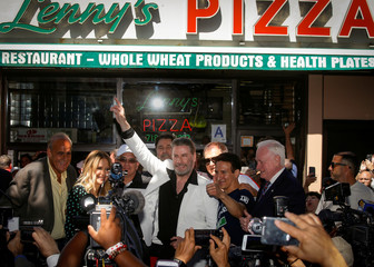 Actor John Travolta appears outside Lenny's Pizza, to promote his upcoming movie 'Gotti' in the Bensonhurst neighborhood of Brooklyn, New York