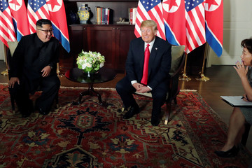 U.S. President Trump and North Korea's Kim meet at the start of their summit in Singapore