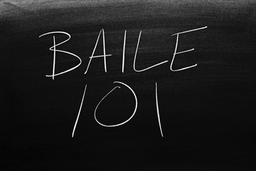 The words Baile 101 on a blackboard in chalk.  Translation: Dancing 101