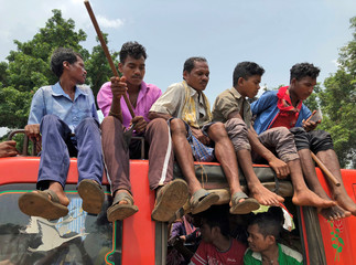 Members of the Dongria Kondh tribe arrive to attend a protest rally demanding the ouster of a Vedanta Limited alumina plant in Lanjigarh