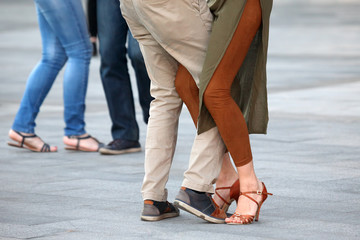 Feet of dancing couples on the street