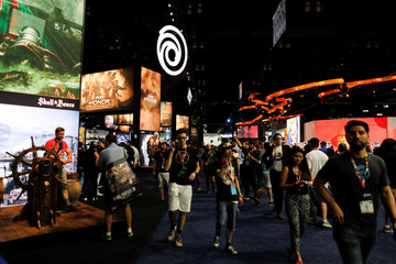 Attendees walk the floor at E3, the world's largest video game industry convention in Los Angeles