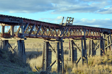 Old abandoned wooden railway bridge over the Boorowa River, in rural central west NSW, Australia