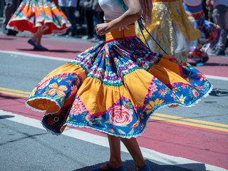Woman showing dance moves wearing a Mexican fiesta dress
