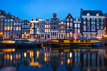 Canvas Prints Amsterdam Amsterdam canal with typical dutch houses and houseboats at evening with beautiful water reflections, Holland, Netherlands.