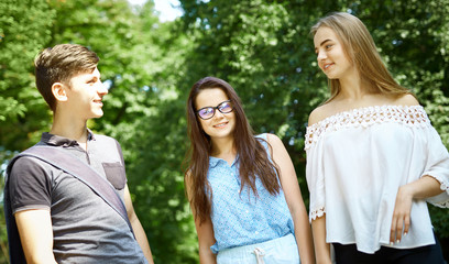 happy friends students perfectly spend time together on a walk in the Park
