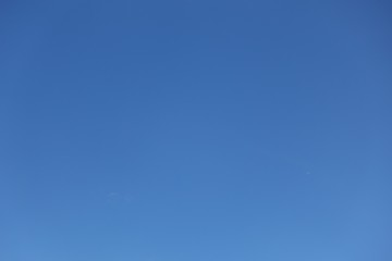 Sky, clear blue sky background with clouds and space in the middle.