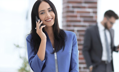 Attractive brunette businesswoman talking on mobile phone