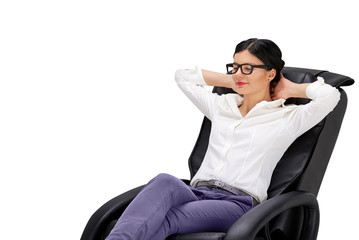 Young woman sitting on relaxing massage armchair