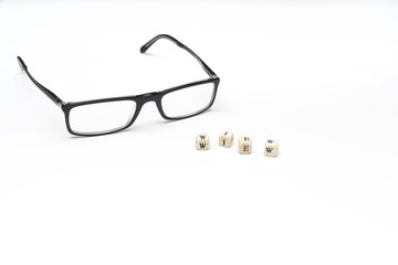 the word view and a pair of glasses on a white surface