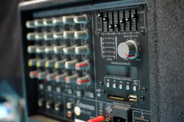 Selective focus Master Volumn button of audio mixer sound.