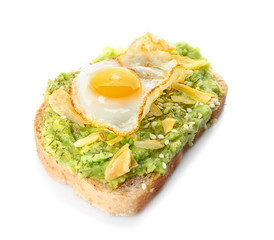 Delicious toast with avocado and egg on white background