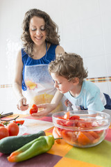 A woman and a child cooking together.