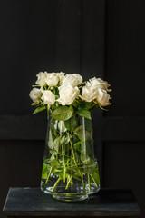 White roses against black background