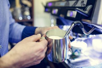 Image of barista man with sautepan in hands