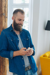 Hipster young man with beard and short hair