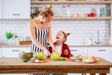 Image of woman with daughter cooking food in kitchen