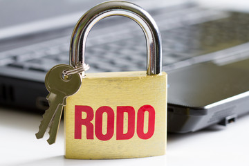 Rodo personal data protection concept with padlock and laptop