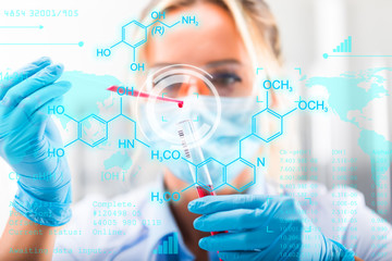 Young attractive female scientist researching in the laboratory