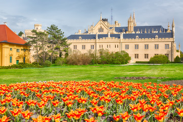 Castle Lednice with nice orange flowers in spring. UNESCO world heritage, Czech republic, South Moravia region.
