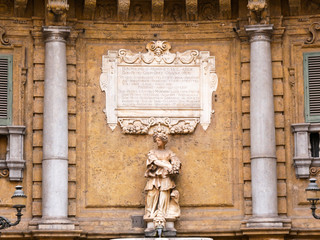 Palermo, Italy April, 2018: Statues representing the spring at the Quattro Canti, Palermo Baroque facade at the sout corner in the historic center of Palermo
