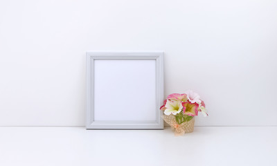 Square frame mockup, pink flowers, white background
