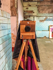 old photo camera with a wooden stand