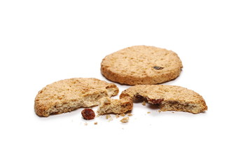 Round whole wheat biscuits with raisins isolated on white background
