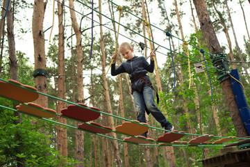 Boy climbing at adventure park
