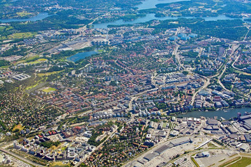 Aerial shot over Solna and Bromma airport below
