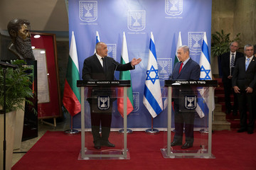 Bulgarian Prime Minister Boyko Borissov gestures as he stands next to Israeli Prime Minister Benjamin Netanyahu during a meeting at the prime minister's office in Jerusalem