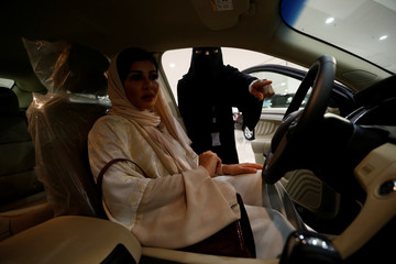 Saudi female surgeon Fatima al-Nasseralah checks her future car at Riyadh's showroom ahead of being able to practice the right to drive in the conservative kingdom later this month