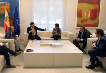 Spain's Prime Minister Pedro Sanchez gestures during a meeting with union leaders and Labour Minister Magdalena Valerio at the Moncloa Palace in Madrid