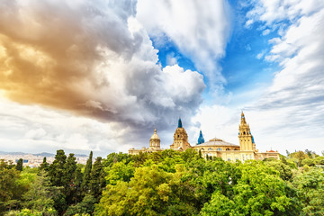 Barcelona, Spain. Building of National Art museum of Catalunya in the forest at the dramatic sky background.