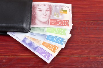 Money from Sweden in the black wallet