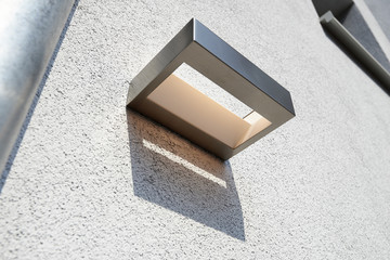 Exterior wall light on renovated plaster structure