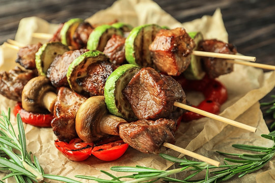 Barbecue skewers with juicy meat and vegetables on parchment
