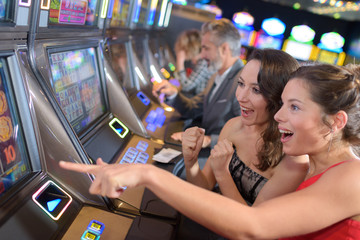 women playing slot machine