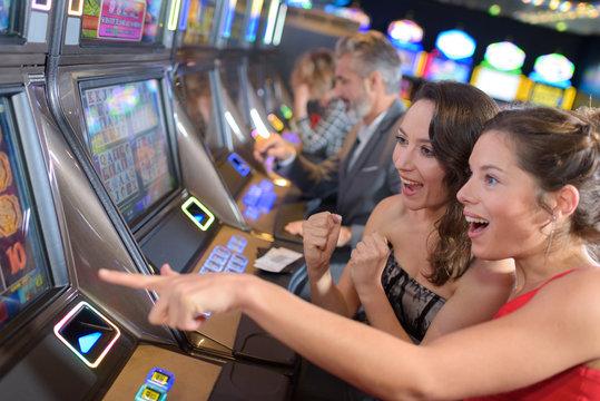 women playing slot machine