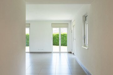 Empty room with window and totally white walls