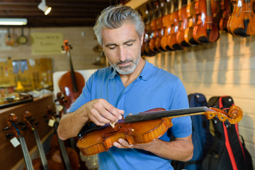 Luthier inspecting violin