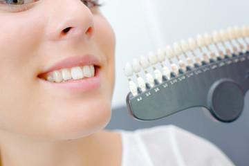Lady holding teeth samples