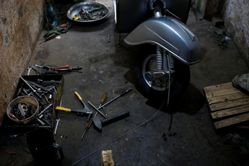 A Vespa scooter is seen at a workshop in Karachi