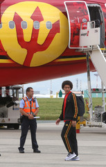 Belgian national soccer team player Axel Witsel walks on the tarmac before the departure of the Belgian squad to Russia, at Brussels' national airport in Zaventem