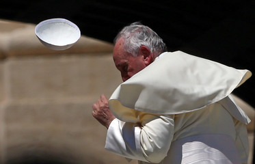 Pope Francis loses his skull cap during the Wednesday general audience in Saint Peter's square at the Vatican