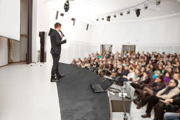 Speaker at a business conference and presentation.