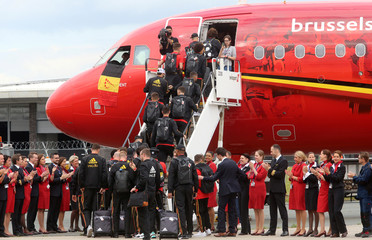 Belgian national soccer team players embark an aircraft on their way to Russia at Brussels' national airport in Zaventem