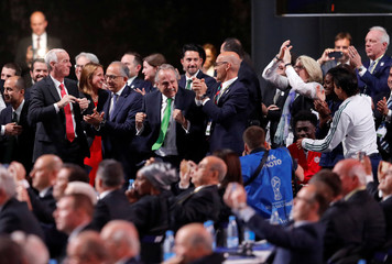 Officials celebrate after the announcement, that the 2026 FIFA World Cup will be held in the United States, Mexico and Canada, during the 68th FIFA Congress in Moscow
