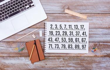 List of Prime Numbers below 100, office desk flat lay